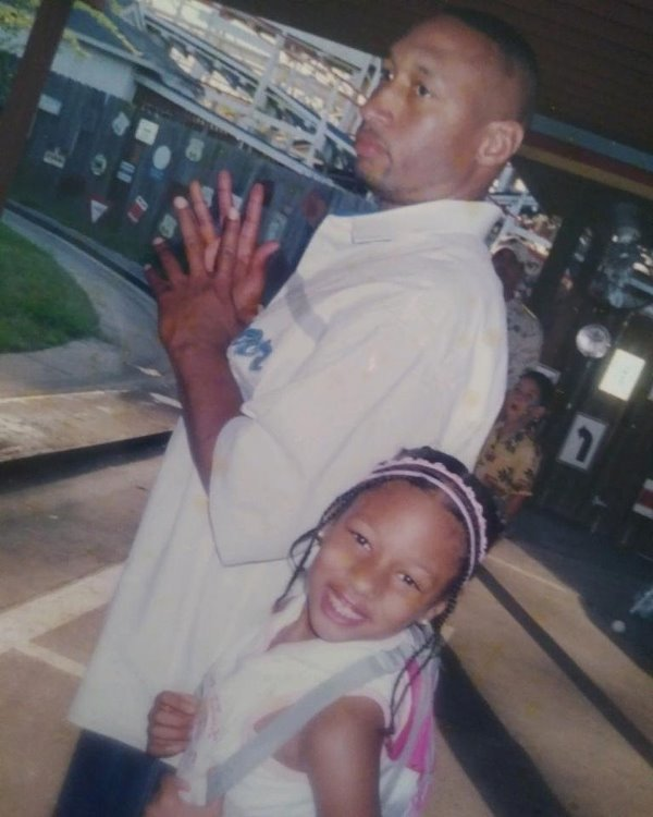 Childhood picture of Megan Thee Stallion with her father