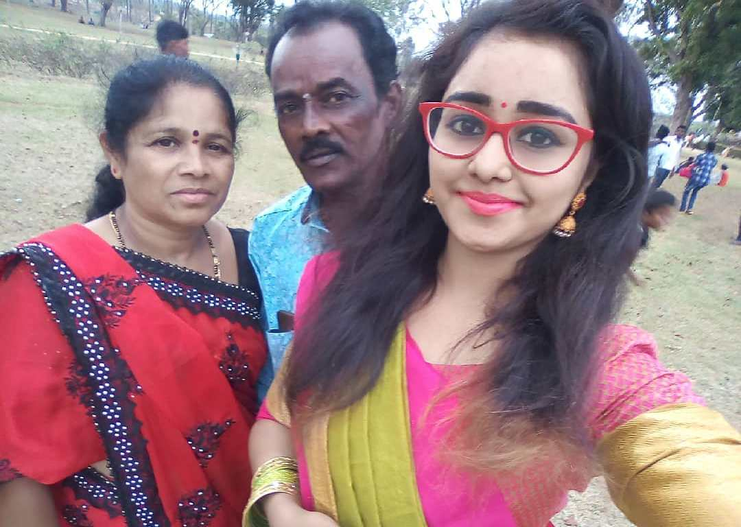 Dhanushree with her parents
