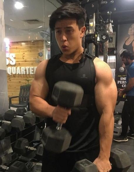 Gary Lu working out in a gym