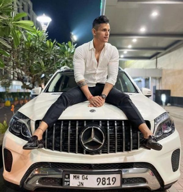 Jay Dudhane posing with his Mercedes
