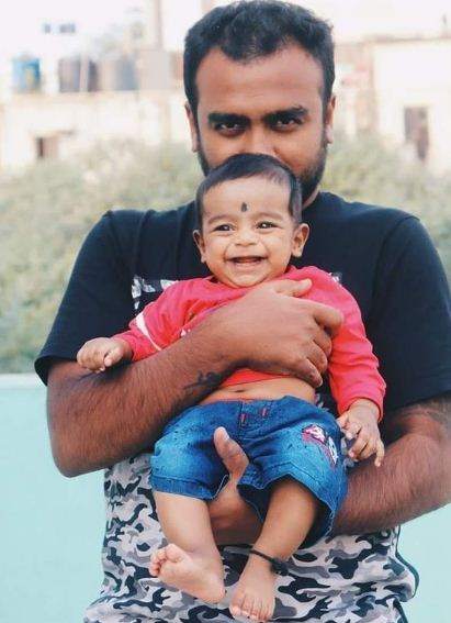 Raghu Gowda with his son