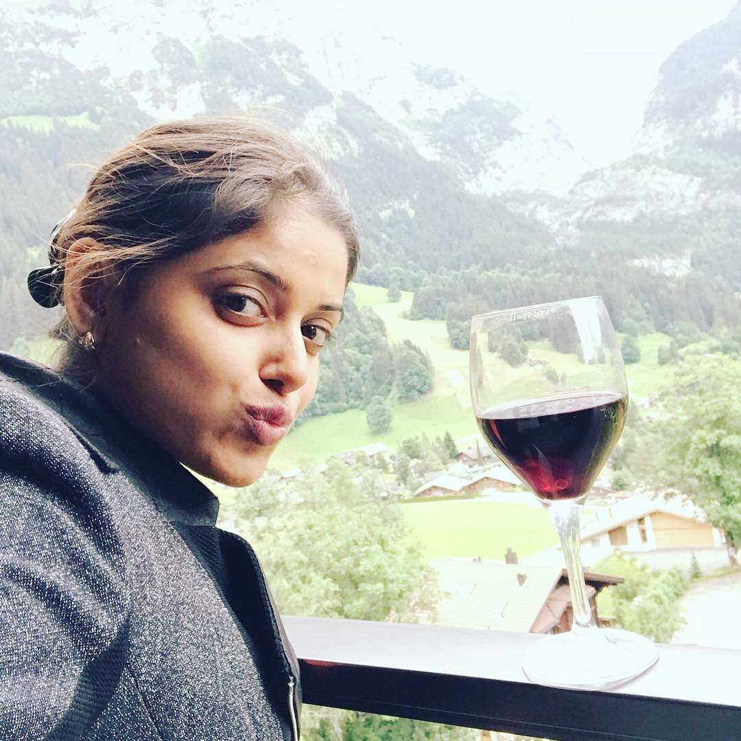 Sneha Paul with a glass of wine