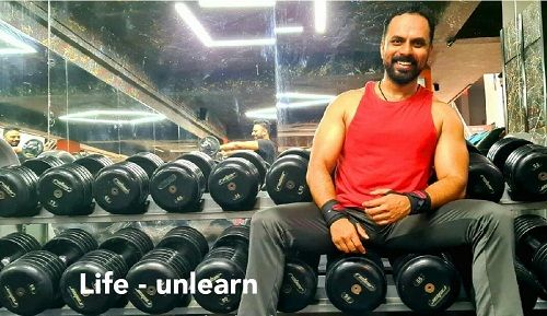 Chakravarthy Chandrachud working out in the gym