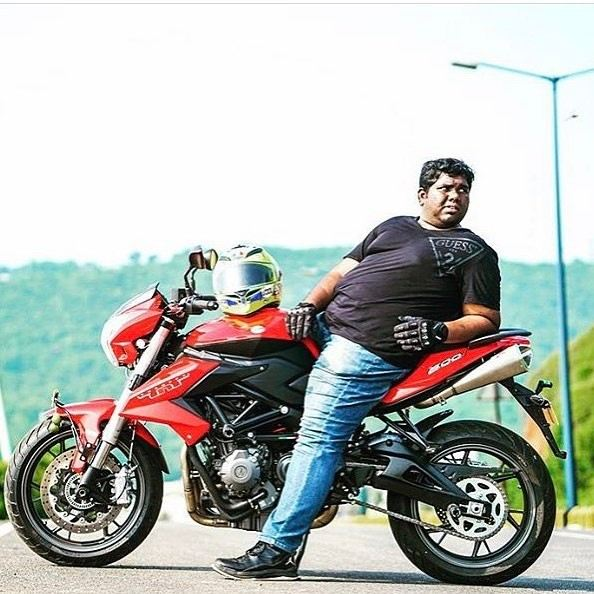 Harsha Chemudu with his bike
