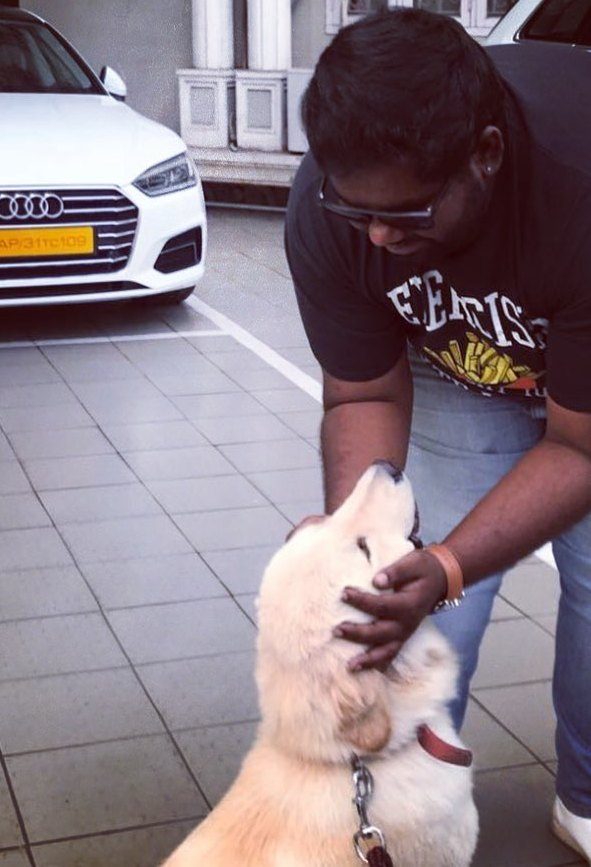 Harsha Chemudu with his pet dog