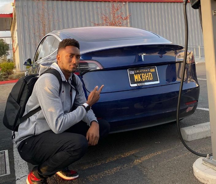 Marques Brownlee posing with his car