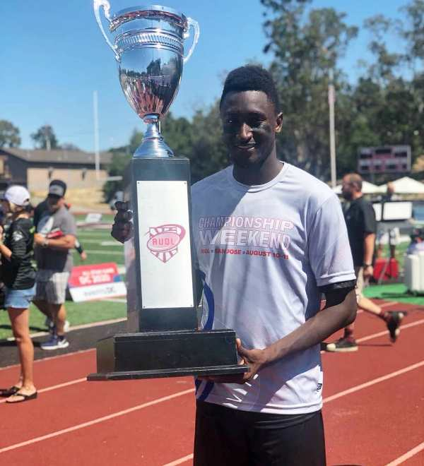 Marques Brownlee posing with the trophy of AUDL