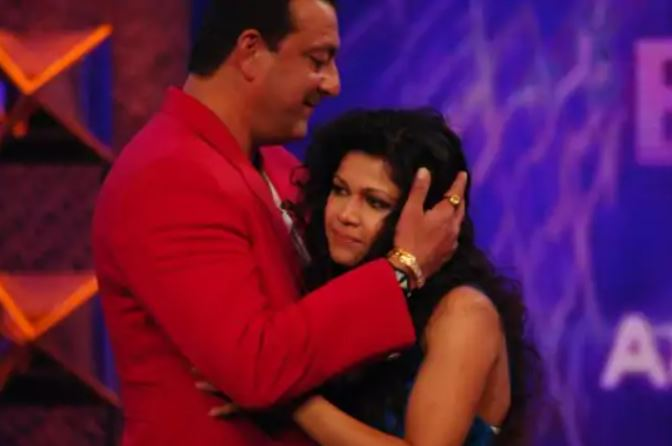 Nihita Biswas being welcomed by the then Bigg Boss show host Sanjay Dutt