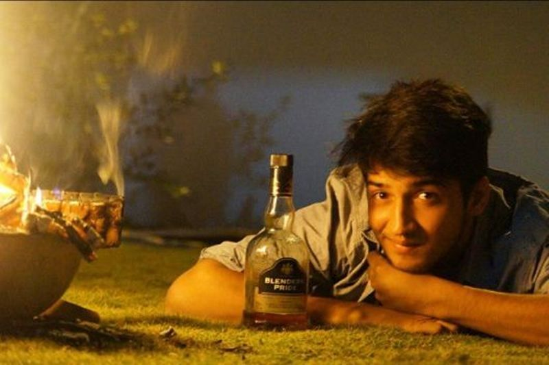 Rajat Verma Holding A Bottle Of Alcohol