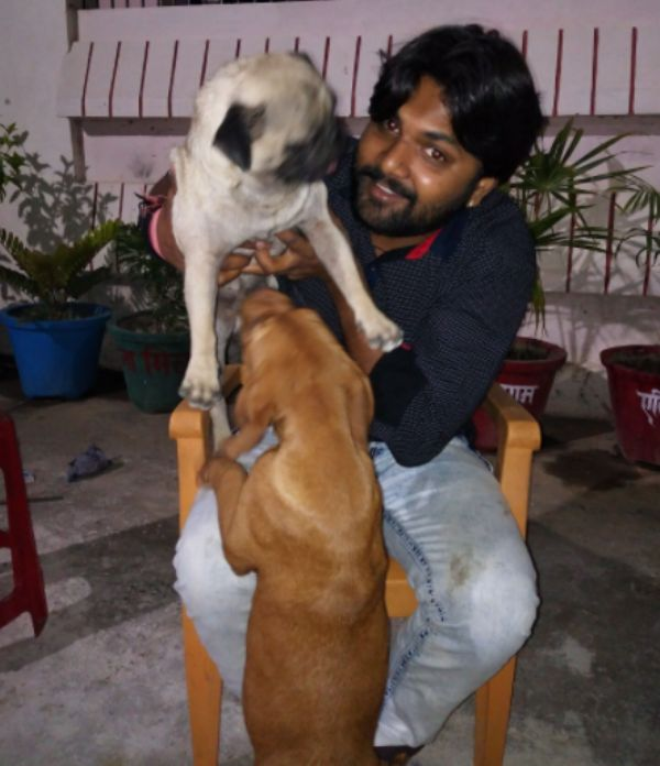 Samar Singh with his pet dogs