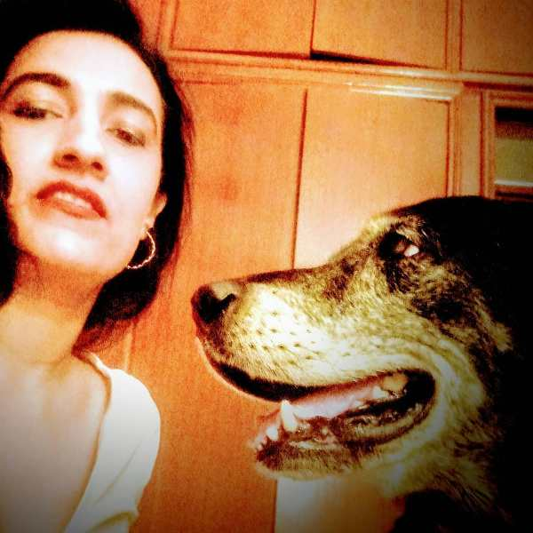 Karuna with her dog, Tigger