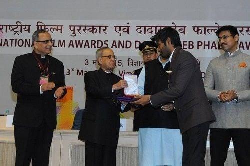 Dhanush receiving National Film Award