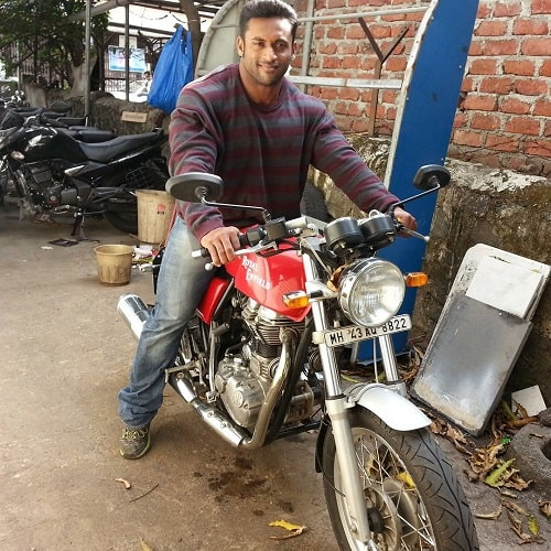 Jagdish Lad sitting on his motorcycle