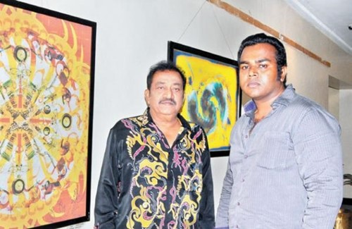 Pandu with his son P Panju during their art exhibition