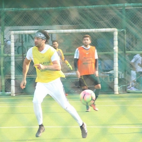 Ronnie C. playing football with Ranbir Kapoor