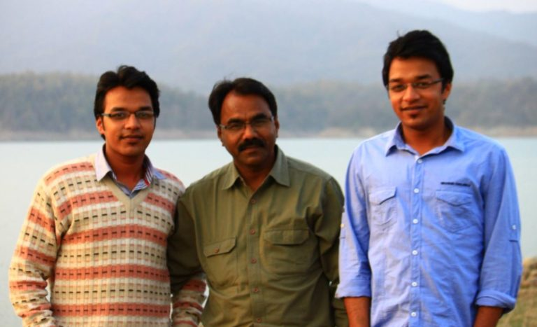 Apoorv Singh Karki with his father and brother
