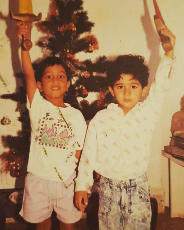Imaad Shah (right) in childhood