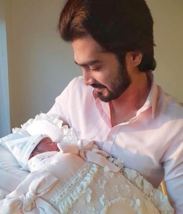 Shahzad Sheikh holding his daughter