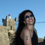 Shobhaa De with a tatoo on her right arm