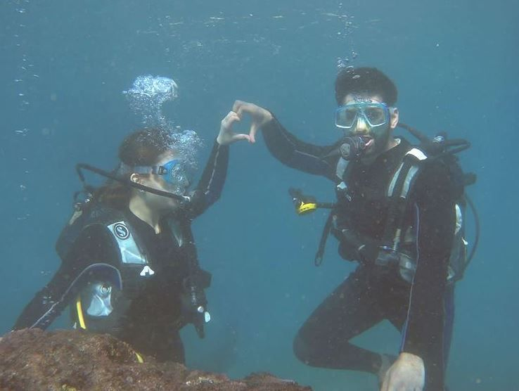 Aiman Khan with her husband performing an underwater sports activity