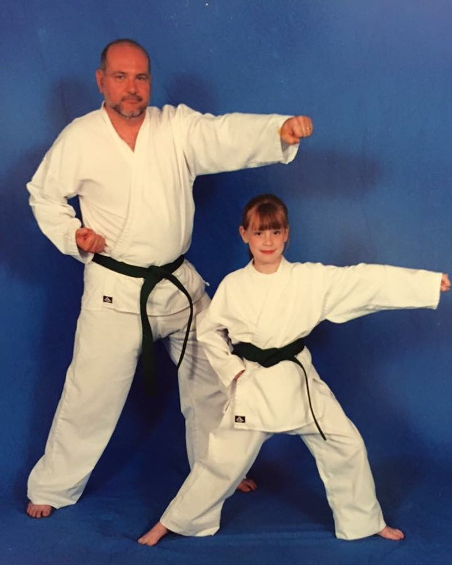 A childhood picture of Hayley while practising Taekwondo with her father