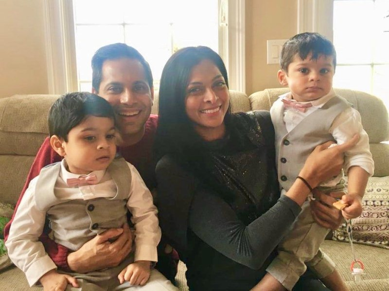 Nina Manuel with her husband and two sons
