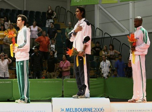 Sharath Kamal (middle) after winning a gold medal in the 2006 Commonwealth Games