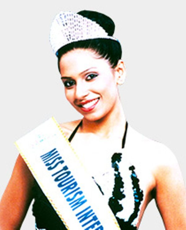 Candice Pinto as Miss Tourism International 2002