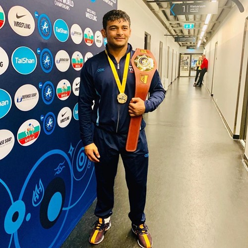 Deepak Punia after winning the gold medal and belt at the Asian Wrestling Championships