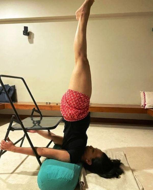 Rujuta Diwekar practising yoga