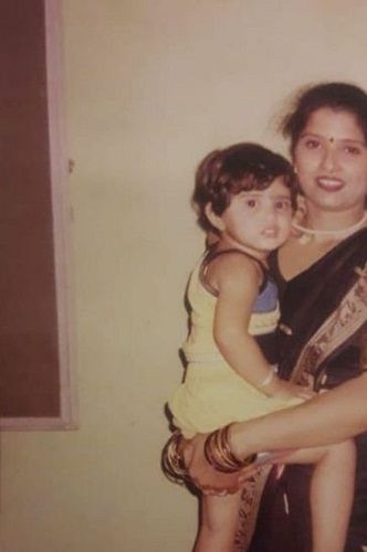 A childhood picture of Ashima Chaudhary with her mother