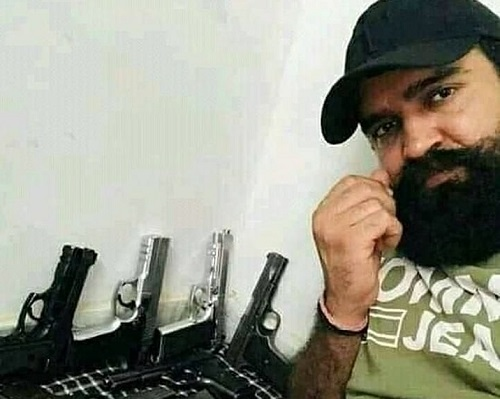 Jitender Gogi with his weapons