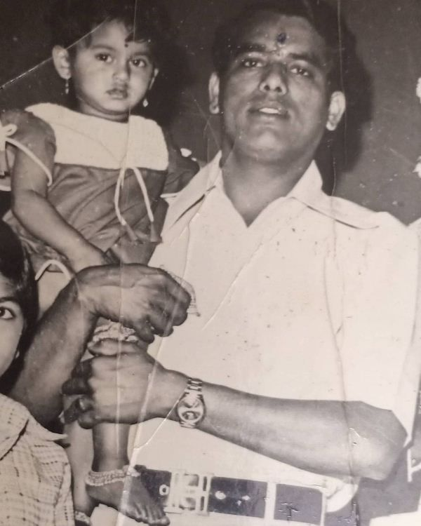 Surekha as a child with her father