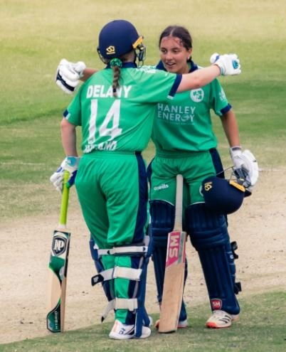 Amy Hunter acknowledged by her partner after scoring the century
